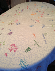 this hand decorated table cloth has become a family tradition