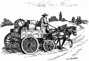 Wagon loaded with belongings on the open road.
